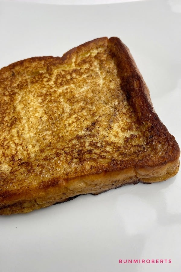A picture of cinnamon French toast on a white plate