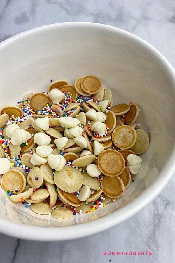 Tiktok cereal pancakes served with white chocolate chips and sprinkles
