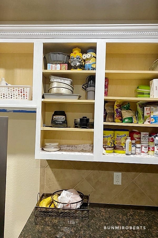 kitchen cabinet with things on the shelves