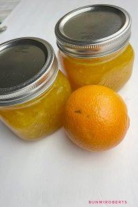 Orange jam in two medium jars
