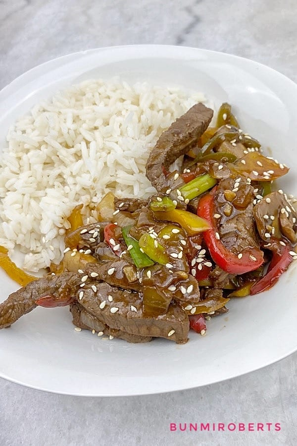 beef and mushroom stir fry served with rice