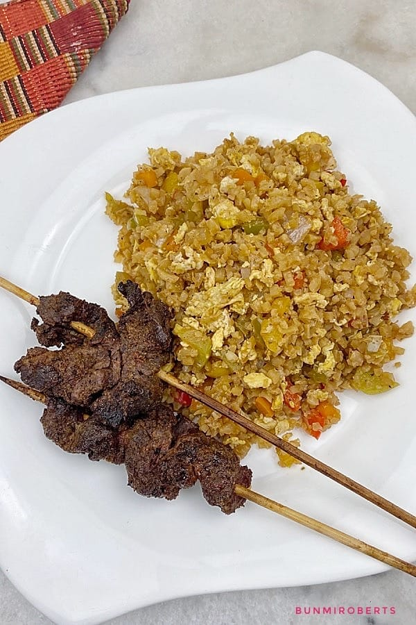 picture of cauliflower rice in a bowl with meat kebab