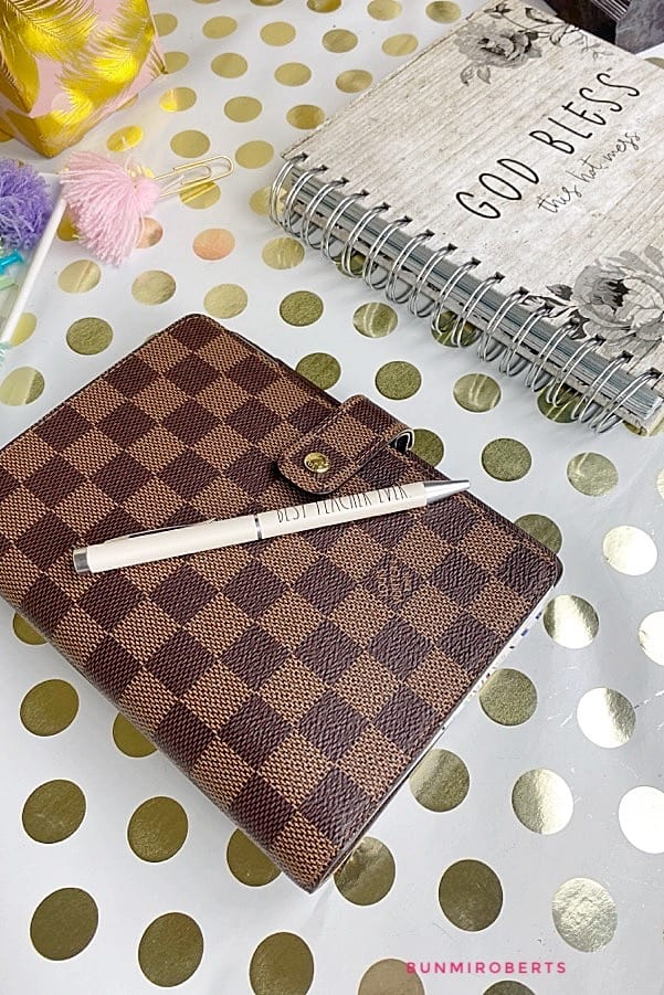 Louis Vuitton Damien PM planner with are Dunn pen and a God bless planner beside it