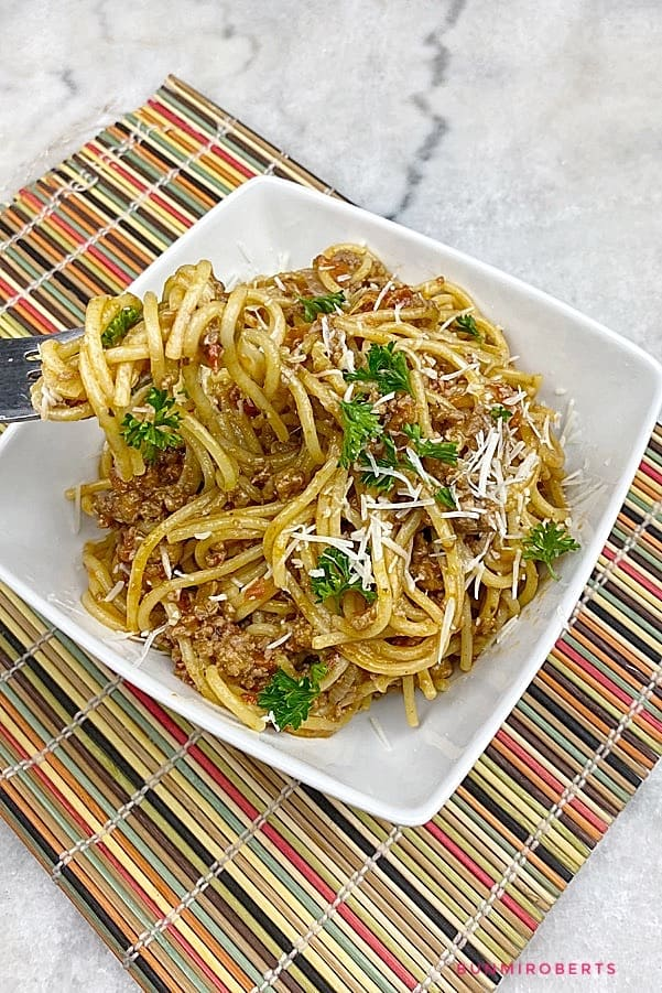 one pot spaghetti served with grated parmesan cheese and parsley