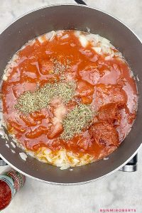garlic, onions, olive oil, tomato paste, crushed tomatoes and herbs