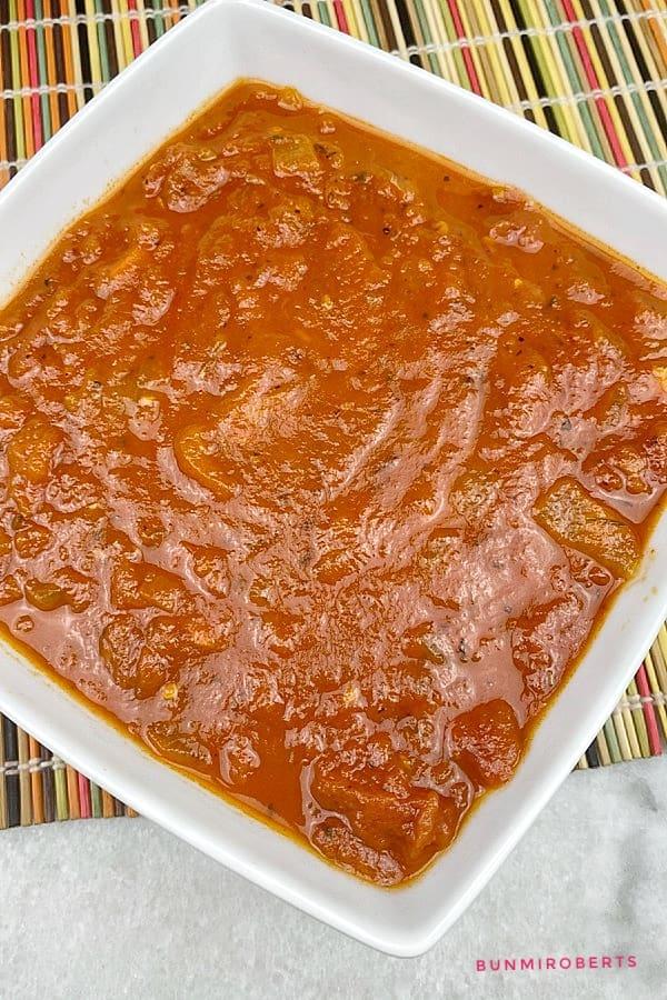 marinara sauce in a white dish